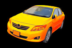 New Golden Toyota Corolla. 2009 model colourful Toyota Corolla isolated on black Stock Images