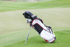 New golf bag over the green field with blurred background of g Royalty Free Stock Photo