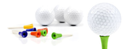 New golf balls and pins Royalty Free Stock Photos
