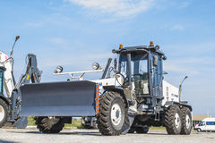 The new grader parked on a clear day with blue sky. Stock Images