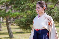 New Graduate Hope. A pretty young Japanese woman dressed in a kimono, obi, and hakama looks right toward a bright future on her university graduation day Royalty Free Stock Photography