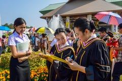 New graduates fill in the questionnaire. CHIANGMAI  THAILAND OCTOBER 19 : Unidentified New graduatesat Chiangmai Rajabhat University Saluang - Khi Lek campus Stock Photo