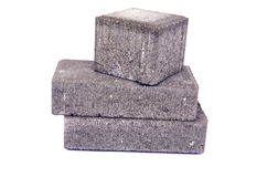 New gray decorative street pavement concrete bricks paving stone isolated Stock Photo