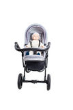 New gray modern pram with doll. Royalty Free Stock Photography
