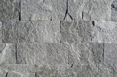 New gray stone cladding plates on wall. Closeup Stock Photos