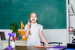 New great idea. small child in classroom. back to school. future success is studying. digital age with modern technology. Small girl study with in school stock images