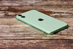 Free New Green Apple IPhone 11 On A Wooden Background. Royalty Free Stock Photo - 162506385