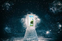 New green worlds behind the door. Staircase leads to a door that opens to a new world Stock Photography