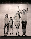 New grunge white and black brick wall. With painted happy family Royalty Free Stock Photo