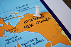 New guinea map. Macro shot of new guinea map with push pin royalty free stock photos