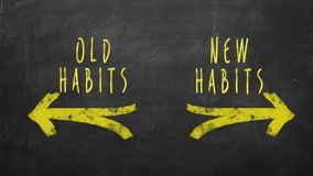 New Habits vs Old Habits. Old Habits - New Habits drawn with yellow arrows on chalkboard Stock Photos