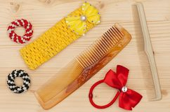 New hairbrush. With accessories over wooden surface Stock Photos