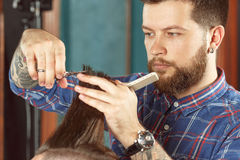New haircut style in barber shop stock photos