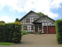 New half-timbered house. With integrated garage Royalty Free Stock Photos