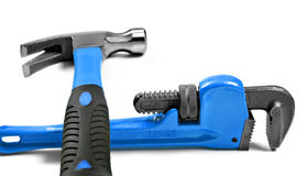 New hammer and wrench on a pure white Stock Photos