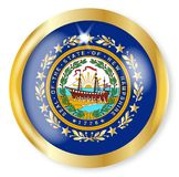 New Hampshire Flag Button. New Hampshire state flag button with a gold metal circular border over a white background Stock Photos