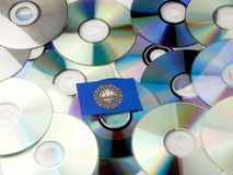 New Hampshire flag on top of CD and DVD pile isolated on white Stock Image