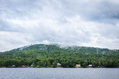 New Hampshire lake on bright cloudy blue day. Beautiful New Hampshire lake on bright cloudy blue day stock photo