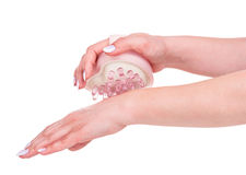 New handheld massager. Handheld massager in a form of heart in the female hands isolated over white background Royalty Free Stock Images