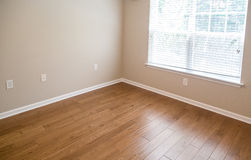 New Hardwood Floor by Sunny Window Royalty Free Stock Photo