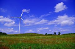 The new harmony. The quiet peacful image of windmill in middle of green fields Stock Photo