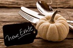 New harvest in German text beside pumpkin Stock Photo