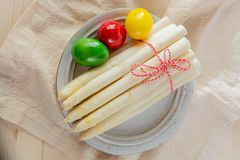 New harvest of white asparagus and colored Easter eggs, high quality raw asparagus in spring season, ingredients for Easter dinner. Close up royalty free stock images