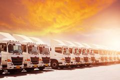 New haulage truck fleet is parking narrow at yard with sunset stock photos