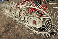 New hay raker farm equipment. Stock Image