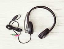 New headset with microphone on the wooden background Royalty Free Stock Image
