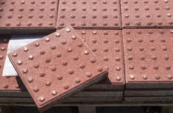 New heap of red paving for the blind Royalty Free Stock Photos