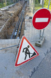 New heating system pipes and road signs on street Stock Photography