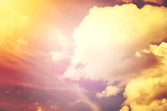A new heaven and earth concept: Dramatic sun ray with orange sky and clouds dawn texture background stock photography