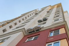 New high rise block building with air conditioners on facade. Modern apartments style. stock image