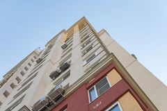 New high rise block building with air conditioners on facade. Modern apartments style. stock photos