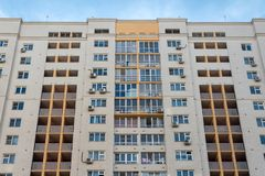 New high rise block building with air conditioners on facade. Modern apartments style. royalty free stock photos