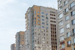 New high rise block building with air conditioners on facade. Modern apartments style. stock images