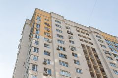 New high rise block building with air conditioners on facade. Modern apartments style. royalty free stock image