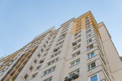 New high rise block building with air conditioners on facade. Modern apartments style. stock photo