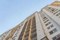 New high rise block building with air conditioners on facade. Modern apartments style. royalty free stock photo