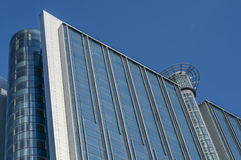 A new high-rise building blue. Facade of high-rise office building from metal and blue glass Stock Images