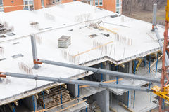 New high-rise building under construction. High angle view of a new high-rise building under construction in a city showing the open concrete framework of the royalty free stock image