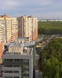 New high-rise buildings in a forested area of the city.The view from the top. Royalty Free Stock Photo