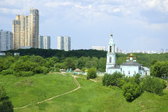 New high-rise buildings and Orthodox Church Stock Photography