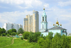 New high-rise buildings and Orthodox Church Stock Photos
