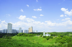 New high-rise buildings and Orthodox Church Royalty Free Stock Photo