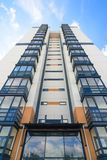 New high-rise house on a background of blue sky. View from the bottom up Royalty Free Stock Photos