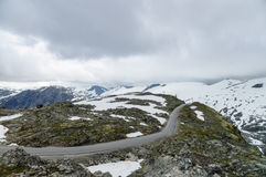New highland road built in snowy mountains Stock Photos
