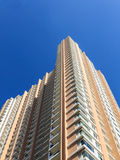 New Highrise Condominium with Blue Sky Background Stock Images