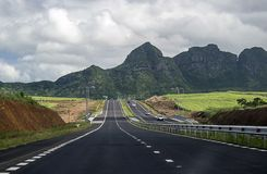 A new highway leading across the Mauritius Island. To the high mountains of volcanic origin Royalty Free Stock Photography